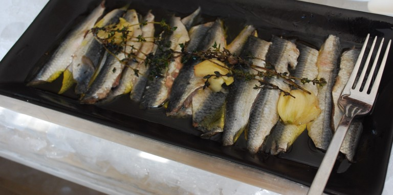 Sardines pickled in garlic and oil
